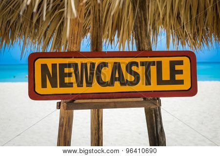 Newcastle sign with beach background