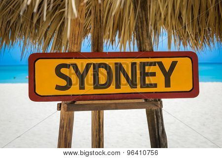 Sydney sign with beach background