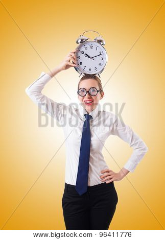Nerd businesswoman with gian alarm clock