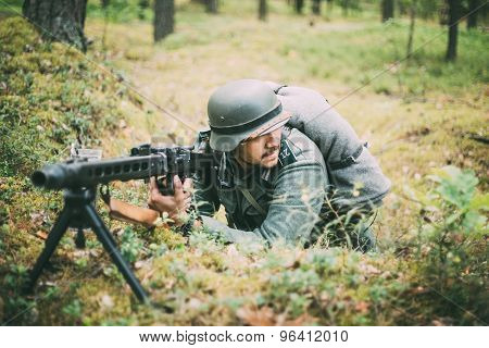 Unidentified re-enactor dressed as German soldier machine-gunner