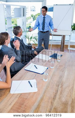 Business people applauding during a meeting in the office