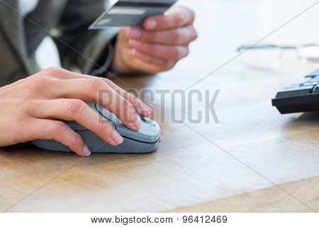 Businessman pay with credit card on internet on the office