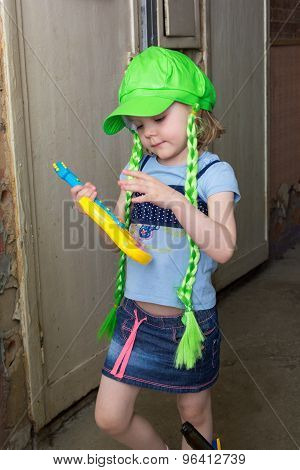 Little Girl Rock Star In Wig Play Guitar