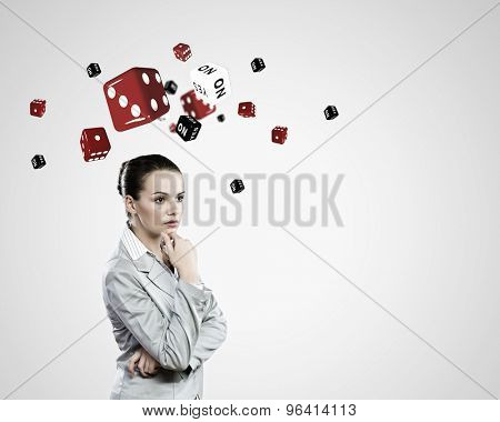 Young pretty thoughtful woman trying to make decision
