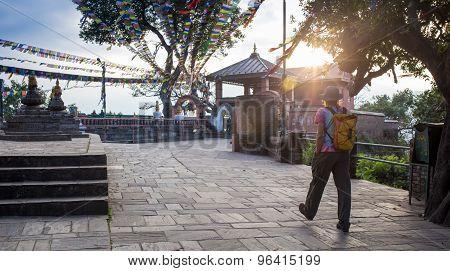 A man near the Buddhist stupa - Tourist