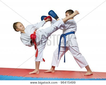 The blows kizami tsuki and ura mavashi geri beats sportsmens in karategi