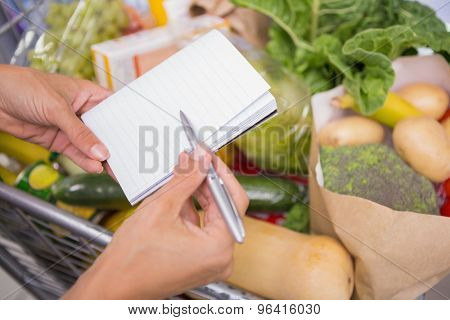 close up view of a notepad above a cart of product