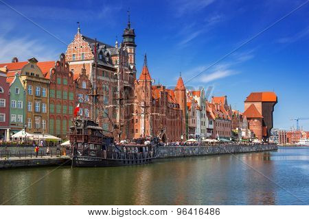 GDANSK, POLAND - MAY 11, 2015: Old town of Gdansk with reflection in Motlawa river. Gdansk is the historical capital of Polish Pomerania with medieval old town architecture.