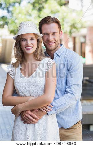 Portrait of a cute couple hugging each other