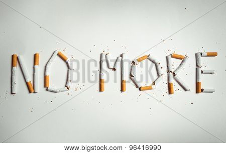 Cigarette arranged as a word no more