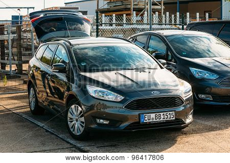 The Ford Focus car with an open trunk standing in the parking lo