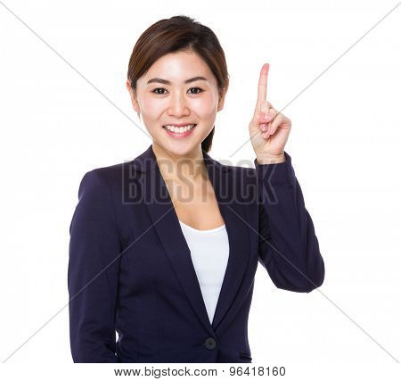 Asian businesswoman showing finger point up