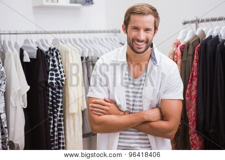 Portrait of smiling man looking at camera at a boutique