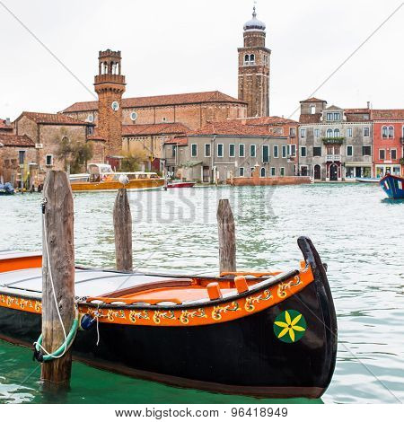 Colorful Gondola Boat At The Water, Venetian Houses And Canal View