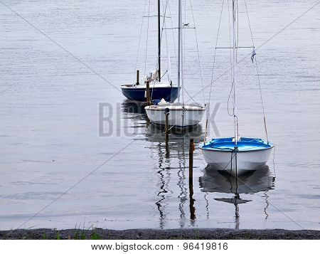Small Sailboats Moored At Sea