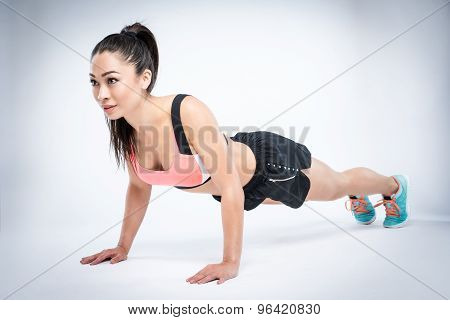 Fit Workout Girl In Press Up Position