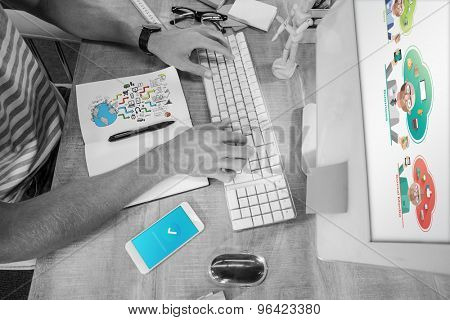 Brainstorm graphic against casual businessman typing on keyboard