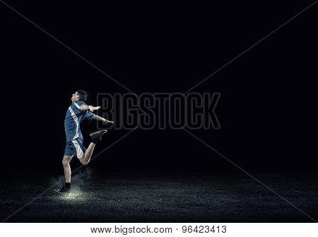 Running man in blue sport wear on black background