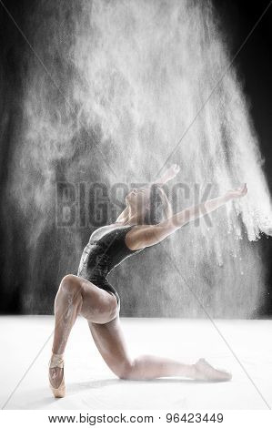 ballerina dancing with flour