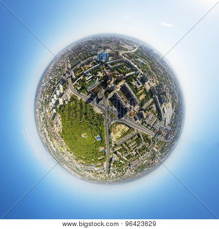 Aerial view of downtown. Crossroads, houses, buildings and parks. Little planet sphere.