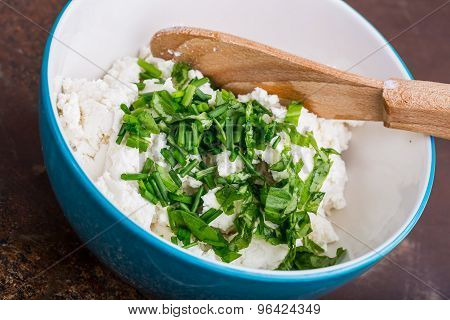 Goat Curd With Fresh Herbs In A Bowl