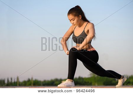 Asian woman outdoor doing stretching