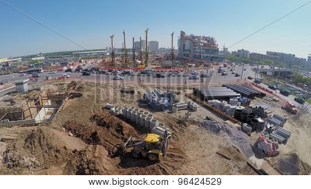 MOSCOW - MAY 25, 2015: Building site of MKZD North-Eastern Tunnel near Shelkovskoe highway with transport traffic at spring sunny day. Aerial view