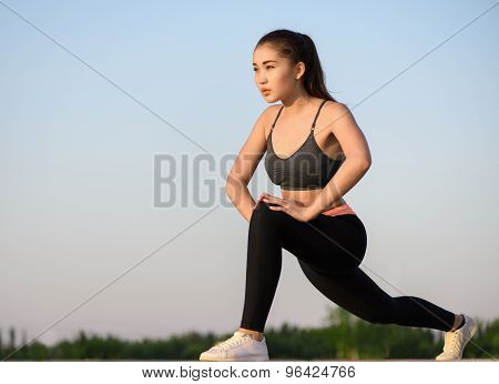 Asian woman doing exercise at the morning outdoor