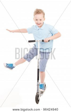 Little boy in shorts and shirt with scooter isolated on white