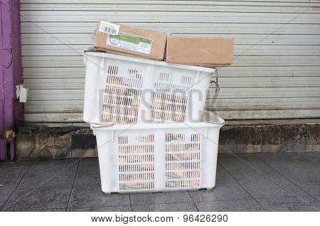 Pile of white plastic basket and paper box