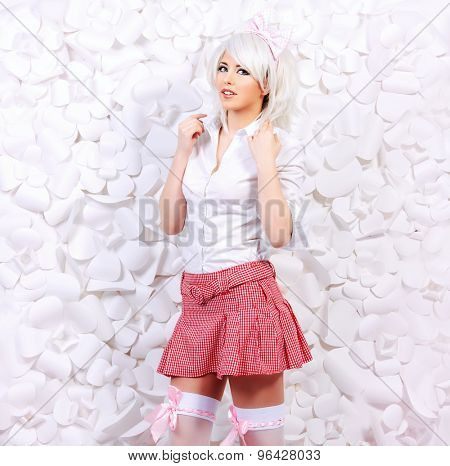 Lovely girl wearing white wig and white blouse with plaid skirt posing over  background of white paper flowers. Anime style.