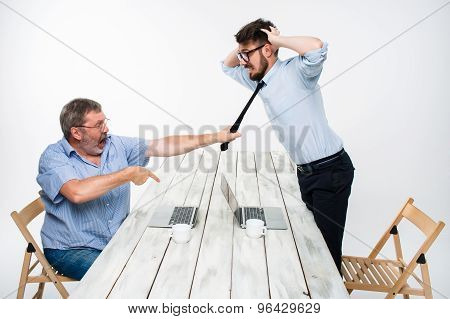 Business conflict. The two men expressing negativity while one man grabbing the necktie of her oppon