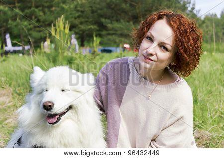 Handsome girl posing with husky