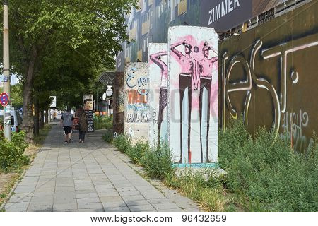 BERLIN, GERMANY - JULY 07: Segments of Berlin Wall in East Berlin filled with grafitti art. July 07, 2015 in Berlin.