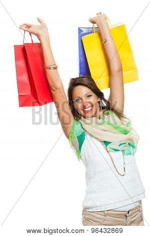 Happy Woman Raising Colored Shopping Bag