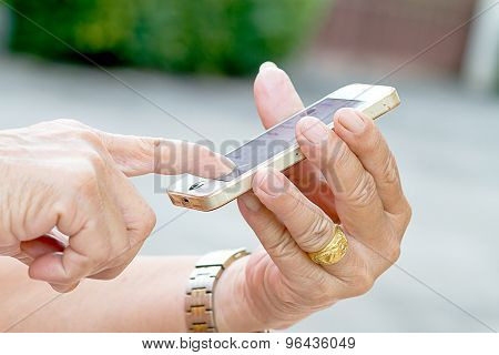 Hand Of Old Man Play With Old  Smartphone Phone