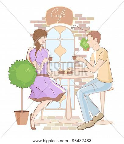 Girl and boy chatting at a cafe