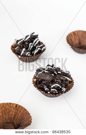 Chocolate crispy rice cake, on white background