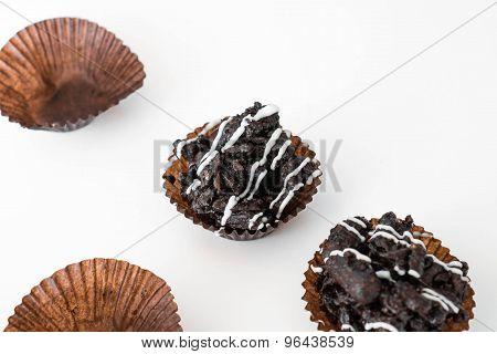Chocolate crispy rice cake, on white background