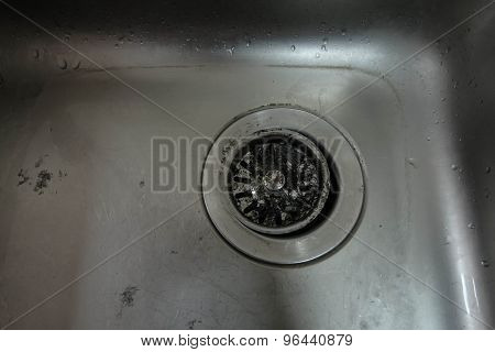 Old dirty stainless sink in the kitchen