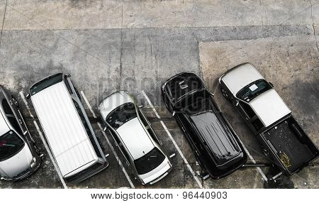Top view of car parking at unidentified residential in the city