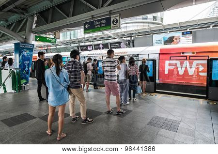 BANGKOK THAILAND - JULY 18 - People standing in lines waiting for BTS sky train at Asoke station on