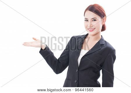 Smiling young businesswoman showing blank area for sign or copyspase, isolated over white background