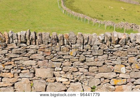Dry stone wall traditional construction The Gower Peninsula South Wales UK with no mortar