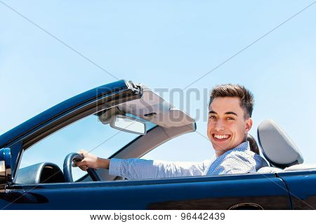 Attractive Young Man Driving Convertible.