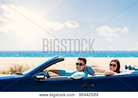 Cute Couple Driving Convertible.