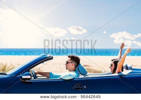Happy Couple Driving Convertible.
