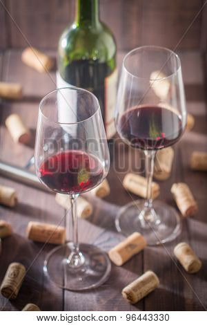 Red Wine Glasses, Bottle And Corks