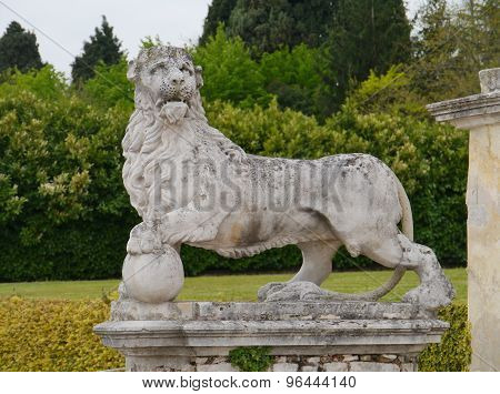 A sculpture of a lion in the garden