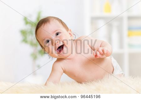 baby crawling on fluffy carpet at home